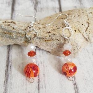 Orange and white glass bead dangle earrings